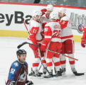 BG0545 Colorado Avalanche Adam Foote strolls by as the Detroit Red Wings celebrate their sixth...