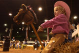 (Denver, CO., January 13, 2004) Claire Lyons, 4, of Fort Lupton waits to compete in the stick...