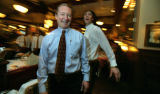 Managing partner of Maggiano's, Bill Billings stands surrounded by workers and customers at lunch...