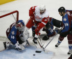 [RMN1306] Detroit Red Wings defenseman Brad Stuart #23 drives on  Colorado Avalanche goalie Jose...