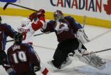 [RMN1437]   Colorado Avalanche goalie Jose Theodore #60 makes a save in the first period of Game 4...