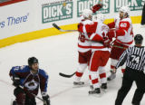 [RMN932] Detroit Red Wings celebrate with right wing Tomas Holmstrom #96 after his goal against...