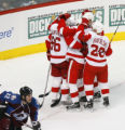 [RMN941] Detroit Red Wings celebrate with right wing Tomas Holmstrom #96 after his goal against...