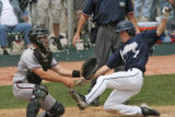 Air Academy James Doyle slides in safe to at home for the winning run in the bottom of the 8th, as...