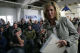 Ashley Grosh (cq) of Littleton, asks a question to a Vestas representative during a recruiting...