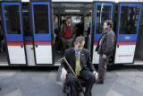 Denver Mayor John Hickenlooper, left, gets off the 16th Street Mall shuttle with disabled advocate...