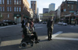 Denver Mayor John Hickenlooper, right, waits for disabled advocate David Kennedy, who was struck...
