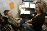 Tammy Snow home school's her 12 year old son  Zachary at their Aurora home Wednesday October 8,...