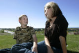 Tammy Snow sits with  her 12 year old son  Zachary at their Aurora home Wednesday October 8, 2008....