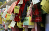 Price tags dangle from clothes at Children's Orchard , a thrift store in Parker on Wednesday...