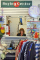 Employee Deidre Huppert (cq) sorts clothes in the buying center at Children's Orchard , a thrift...