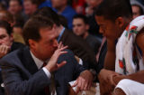 Scott McClurg/Journal-World Photo Bill Self talks with C.J. Giles in the second half.