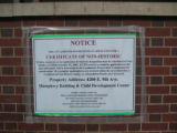 The sign on the Day Care Center of the  CU Health Sciences Center is a notice giving interested...