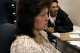(PG17523) Michael Martinez watches as Patricia Garza searches an online job bank for him at the...