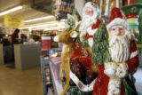 DM0954  Tuesday_Morning_Holiday_Merchandise+55072 Santa Claus ceramics sit on the shelf as a...