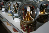 DM0960  Tuesday_Morning_Holiday_Merchandise+55072 Santa Claus snow globes sit on the shelf as a...