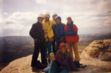 Mike Price, center, in blue jacket, with members of an Outward Bound crew he led in Utah in...