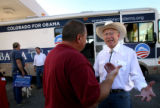 (PG11538) Sen. Ken Salazar talks with undecided voter Frank Freehill while campaigning for Obama...
