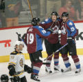 0506 Colorado Avalanche #23 Milan Hejduk , right, celebrates with teammates as he scores one on...