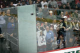 0793 Fans cheer on a broken pane of glass as the Colorado Avalanche take on the Boston Bruins in...