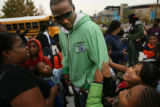 MJM202  Broncos receiver, Brandon Marshall is surrounded by children from Open Door Youth Gang...