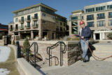 Boulder, CO 01/14/05-- Barry Steudtner of American Design and Landscape waters newly planted...