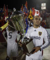 CODZ107 - Real Salt Lake forward Yura Movsisyan holds the Rocky Mountain Cup after his late...