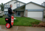 John Lerew powers around on his his segway to handout pamphlets in Aurora, Colo. October 11,...