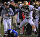 Mullen's Mario Conte, right, is knocked out of bounds by Grandview's Tyler Klaas, in the first...