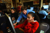 (DENVER, CO. January 11, 2004) North High School teacher Sherrie Clapp helps students Shawntell...