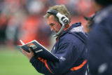 122  Denver Broncos coach Mike Shanahan thumbs through his book of plays against the Jacksonville...