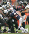 346  Denver Broncos cornerback Champ Bailey #24, tackles Jacksonville Jaguars quarterback David...