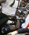 998 Denver Broncos SS Marquand Manuel #33 is scrunched at the bottom of a pile in the fourth...