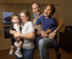 [(Arvada, CO, Shot on: 1/14/05)]  (FROM LEFT) Alex, 20mo., Valerie, 43, Greg, 34, and Jacob, 4,...