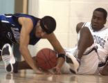 Greeley, Colo., photo taken January 14,2004- Northridge player, Jason Dudley (RIGHT #22) and ...