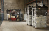 (Denver, Colo., December 31, 2004) Tim Haase, of Northglenn, moves pallets of relief aid destined...