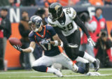 380 Denver Broncos wide receiver Glenn Martinez #17 makes an acrobatic catch with Jacksonville...