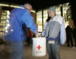 (Denver, CO  on 12/31/2004 ) - American Red Cross volunteer Suzie Lovercheck, right, accepts a...