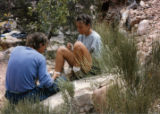 Mike Price wraps the ankle of an Outward Bound student during a 1981 trip in Utah. Price died June...