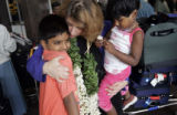 (1/16/05,Chennai, India)  Nanci Ricks greets Ricky George, 10,  and his sister Rehita George, 4, ...