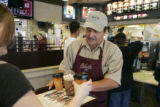 Supervisor Ron Bucar passes out samples of specialty coffee drinks at the McDonalds at 5550 W....