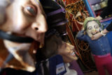 (from left) Marissa Lewis (cq) adjusts a Hillary Clinton mask on her 4 year-old daughter, Audrey...