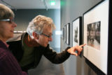 Jean Jameson, left, and husband Markus Steiner look at photographs by Jane Hammond showing at the...