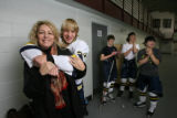 Hockey mom Kimberley Conrad, with her son, Marshall, who's on the Arapahoe Youth Hockey Bantam AA...