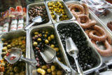 Olives, salamis, and sausage in the front case at Carbone's Sausage Market and Deli on October 24,...