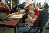 Becky Swan (cq), holds her baby, Kaycee Swan, 3 months, while working the phone bank for McCain...