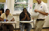 Manual High School sophomore students (from left) Jamaya Brown (cq) and Teague Harrison (cq) laugh...