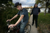 D'Artagnan Dye with his dad Larry Dye behind him tries out his bike for the first time since his...