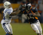 (DENVER, CO., JANUARY 02, 2005) Denver Broncos' #34, Reuben Droughns, right, is pushed out of...