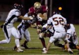 Faith Christian's Ian Henry is swarmed by Eerie tacklers on a punt return in the first half at...